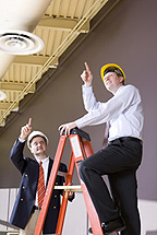 Two men inspecting the safety of a building